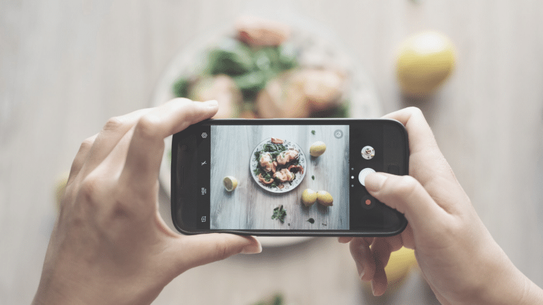 woman taking picture of food for Pinterest